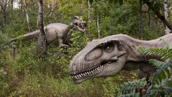 Life-sized animatronic dinosaurs are seen at Field Station: Dinosaurs, a 20-acre outdoor Jurassic learning expedition and family tourist attraction in Secaucus, N.J. on Thursday, Sept. 25, 2014 - Sputnik International