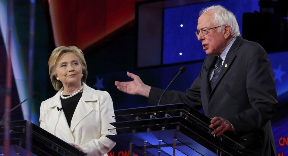 Democratic U.S. presidential candidate Hillary Clinton (L) listens to Senator Bernie Sanders speak during a Democratic debate hosted by CNN and New York One at the Brooklyn Navy Yard in New York April 14, 2016
