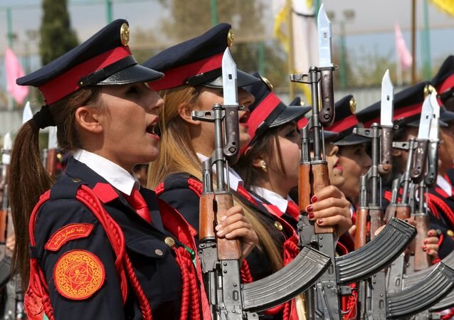 Female Kurdish Peshmerga take part their graduation ceremony at a police academy in Zakho district of the Dohuk Governorate of the Iraqi Kurdistan province, Iraq March 30, 2016