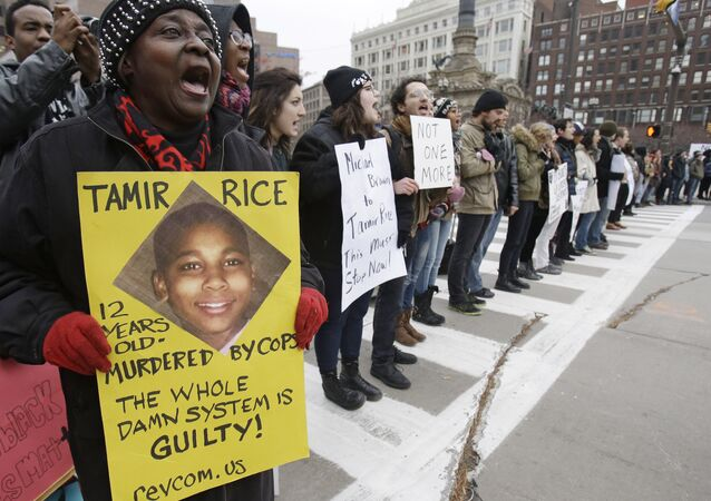 FILE- In this Nov. 25, 2014, file photo, demonstrators block Public Square Tuesday, Nov. 25, 2014, in Cleveland, during a protest over the police shooting of 12-year-old Tamir Rice