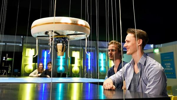 This handout picture released on Tuesday, April 19 by the Eindhoven University of Technology shows a flying drone bringing drinks to customers in the world's first drone cafe in Eindhoven, The Netherlands - Sputnik International