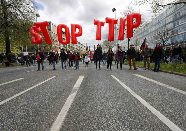 Protesters demonstrate against Transatlantic Trade and Investment Partnership (TTIP) free trade agreement ahead of U.S. President Barack Obama's visit in Hanover, Germany April 23, 2016