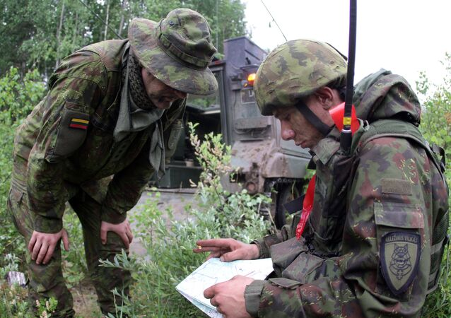 Lithuanian soldiers take part in a field training exercise, file.