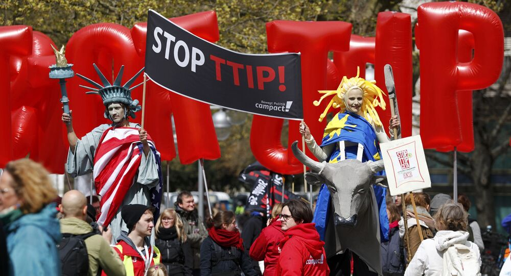 Protesters depicting Statue of Liberty (L) and Europa on the bull take part in a demonstration against Transatlantic Trade and Investment Partnership (TTIP) free trade agreement ahead of U.S. President Barack Obama's visit in Hannover, Germany April 23, 2016