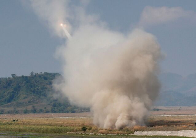 A US military fires a High Mobility Artillery Rocket System (HIMARS) during a military exercise.