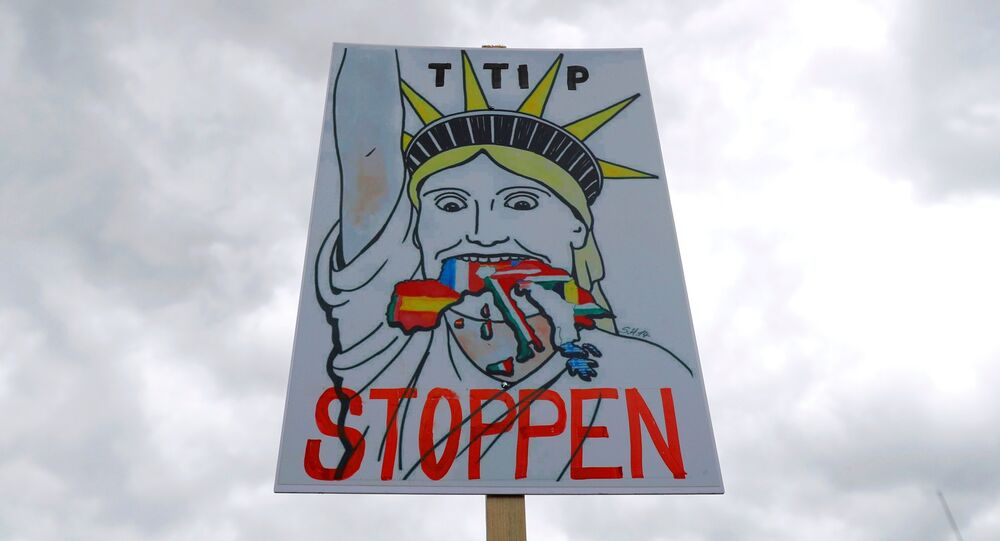 A placard is pictured during demonstration against TTIP free trade agreement ahead of U.S. President Barack Obama's visit in Hanover, Germany April 23, 2016.