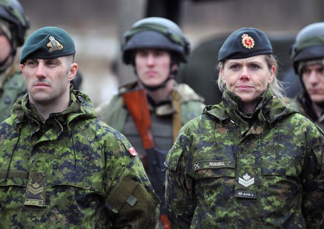 Canadian military instructors, foreground, and Ukrainian servicemen during combat exercises on Yavorsk range in the Lvov region.