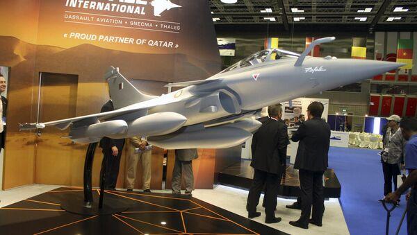 A model of Dassault Rafale fighter jet is seen during Doha International Maritime Defence Exhibition, Qatar March 31, 2016. - Sputnik International