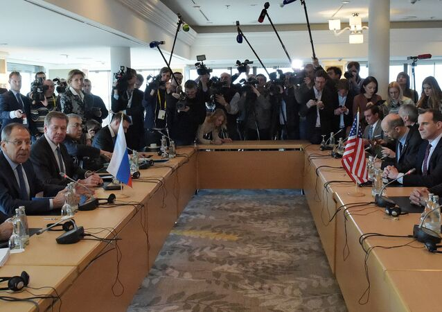 Russian Foreign Minister Sergei Lavrov (second left) and US Secretary of State John Kerry (right) participating in a bilateral meeting on the eve of an International Syria Support Group (ISSG) session in Munich. (File)