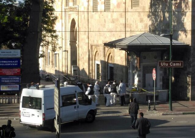 Security forensic officials work after an explosion outside the historical Ulu Cami in Bursa, Turkey, Wednesday, April 27, 2016.
