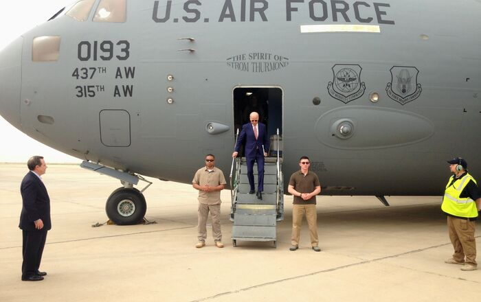 Vice President Joe Biden steps off a C-17 military transport plane upon his arrival in Baghdad, Iraq, Thursday, 28 April 2016.