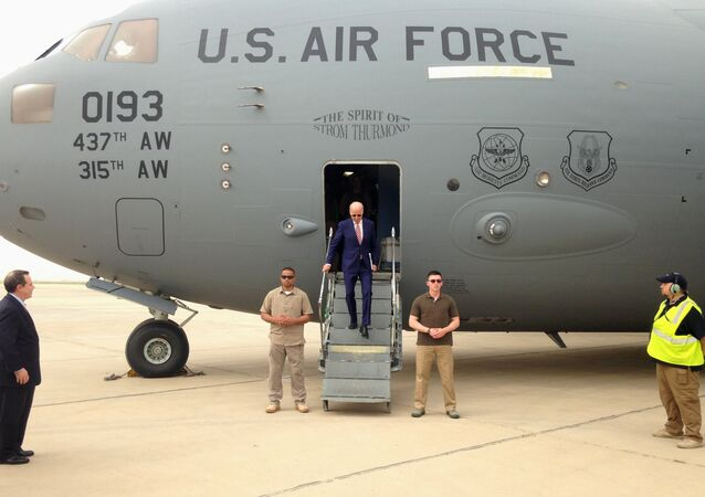 Vice President Joe Biden steps off a C-17 military transport plane upon his arrival in Baghdad, Iraq, Thursday, April 28, 2016.