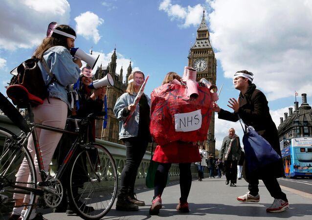 Junior doctors take part in a strike near St Thomas' Hospital in London, Britain April 27, 2016.