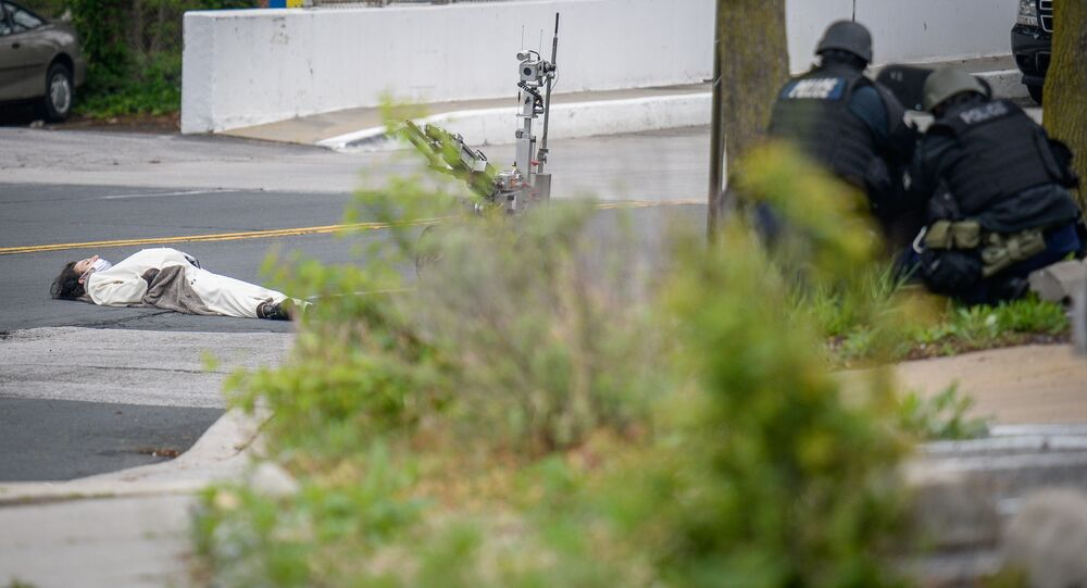 A man, claiming to have a bomb, lies in the street outside of the Fox45 television station in Baltimore.
