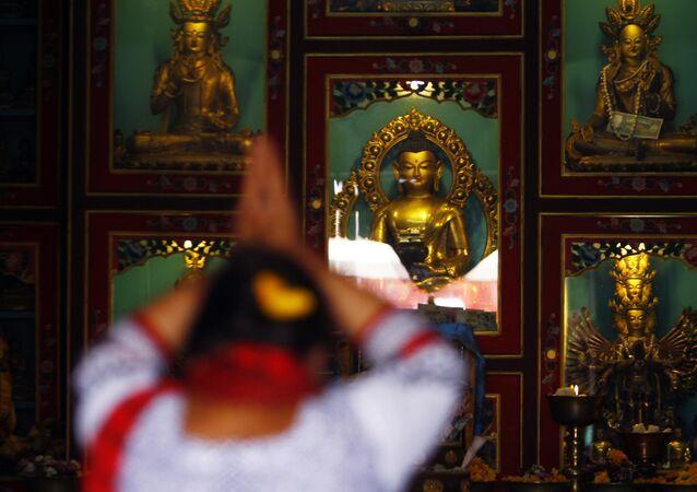 A Buddhist woman offers prayers at a monastery during Buddha Jayanti, or Buddha Purnima, festival in Katmandu, Nepal.