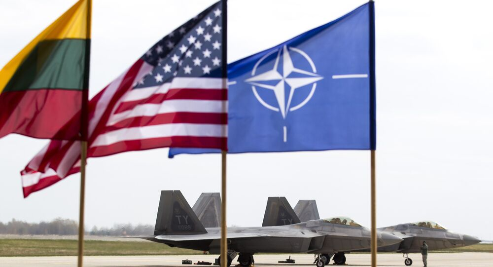 US Air Force F-22 Raptor fighter jets stand on the tarmac after landing at the Siauliai airbase, some 230 km (144 miles) east of the capital Vilnius, Lithuania, Wednesday, April 27, 2016.