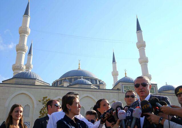 Turkish President Recep Tayyip Erdogan speaks to the media after Eid Al-Fitr prayers in Istanbul.