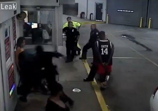 Cop beats handcuffed woman