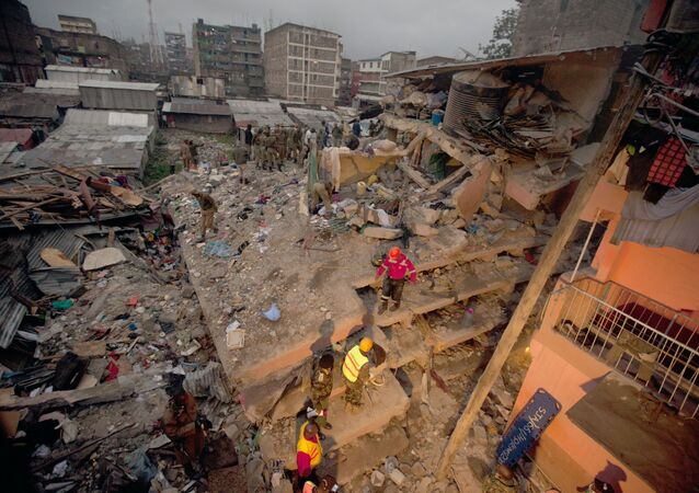 Rescuers work at the site of a building collapse in Nairobi, Kenya, Saturday, April 30, 2016