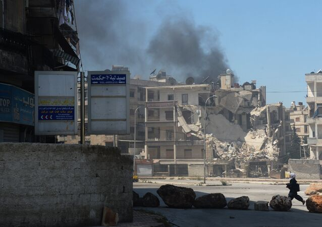 Militants shell a district in Aleppo. File photo