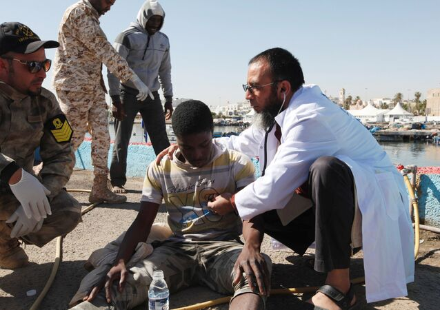 Migrants receive medical treatment in a port, after being rescued at sea by Libyan coast guard, in Tripoli, Libya April 11, 2016