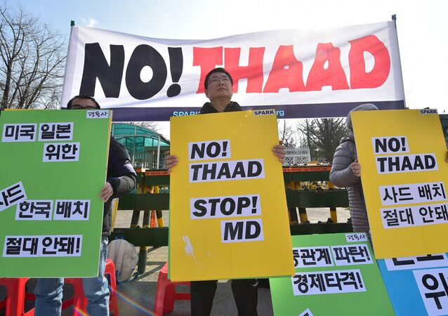 Anti-war activists hold placards during a rally against talks on deployment of the US-built Terminal High Altitude Area Defense, THAAD, outside South Korea's defence ministry in Seoul on March 4, 2016