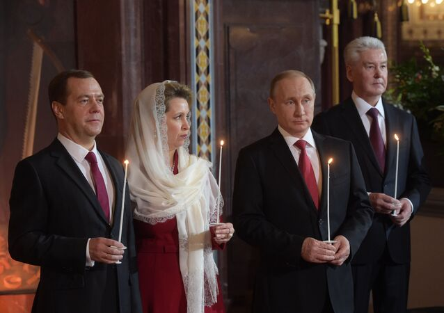 Russian President Vladimir Putin and Russian Prime Minister Dmitry Medvedev attend Easter service at Christ the Savior Cathedral in Moscow