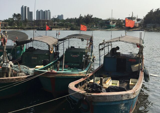Fishing boats with Chinese national flags are seen at a harbour in Tanmen, Hainan province, April 5, 2016