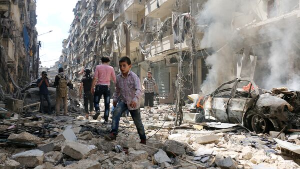People walk amid the rubble of destroyed buildings following a reported air strike on the rebel-held neighbourhood of al-Kalasa in the northern Syrian city of Aleppo, on April 28, 2016 - Sputnik International