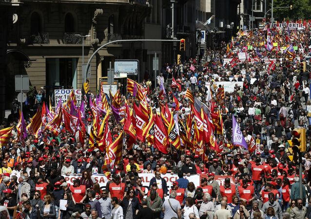 People march during a May Day rally in the center of Barcelona, Spain, Sunday, May 1, 2016