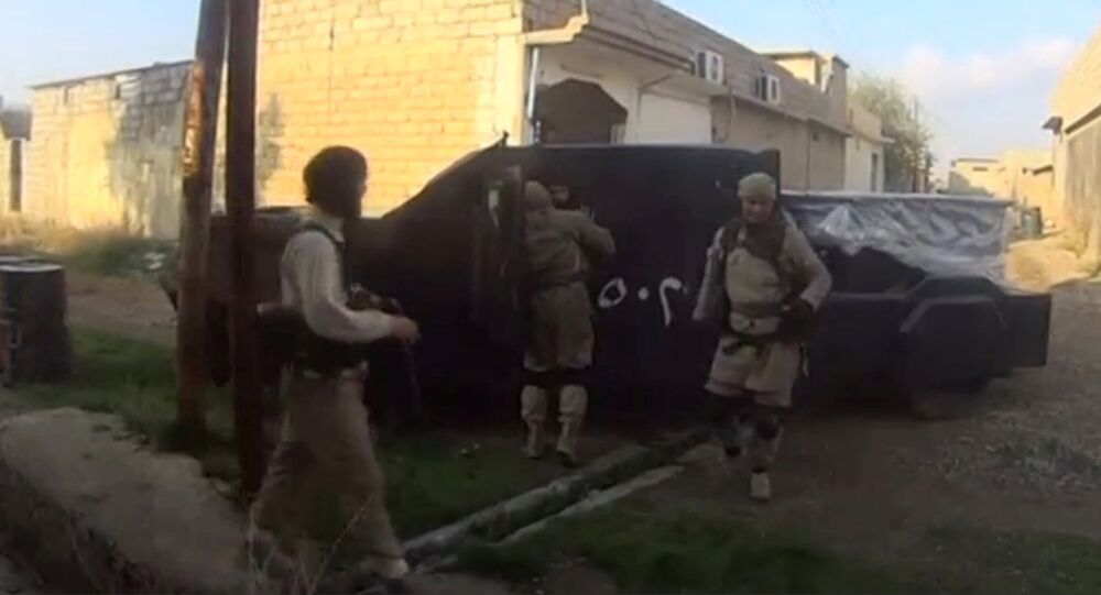 A man in an armoured vehicle, said to be a suicide bomber about to go out on a mission, talks to other Islamic State fighters in Iraq, in this still image taken from an amateur video supplied by Kurdish Peshmerga and received by Reuters on April 29, 2016