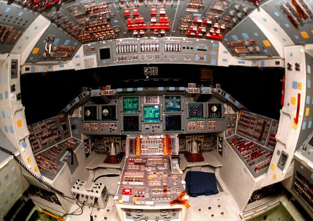 The cockpit of the orbiter Atlantis is seen in the round, revealing the new full-color flat panel Multifunction Electronic Display Subsystem (MEDS), also called the glass cockpit.