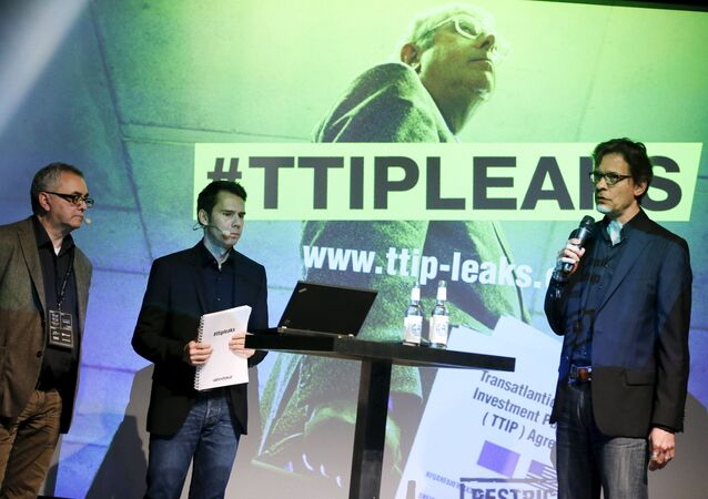 Juergen Knirsch (L-R), Volker Gassner and Stefan Krug of the environmental campaign group Greenpeace address a news conference as they present a copy of the leaked TTIP negotiations in Berlin, Germany, May 2, 2016