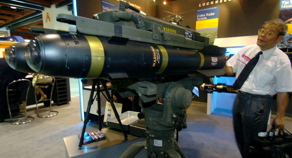 A man looks at the latest US-made Hellfire II missiles during the defence industry exhibition in Taipei, 11 August 2005