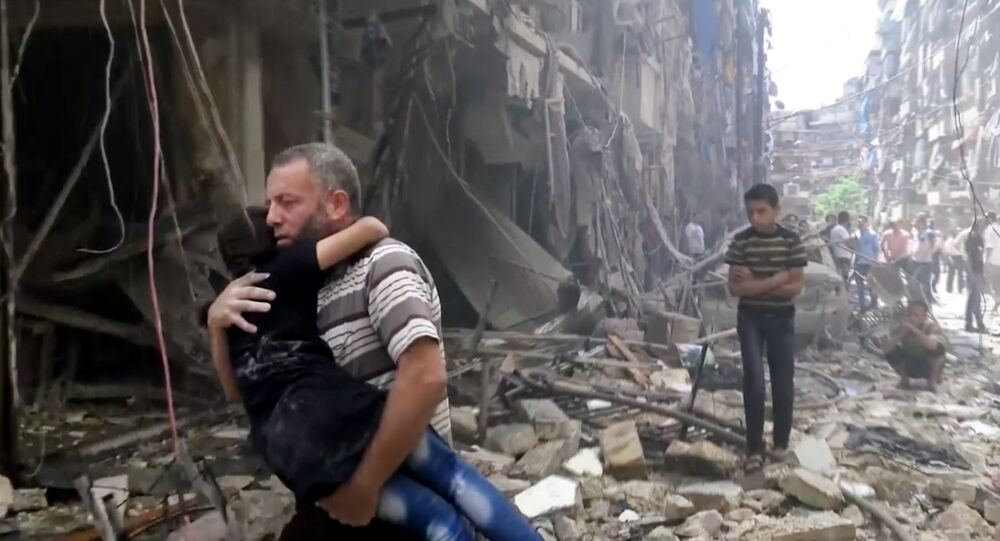 Man carries a child after airstrikes hit Aleppo, Syria, Thursday, April 28, 2016