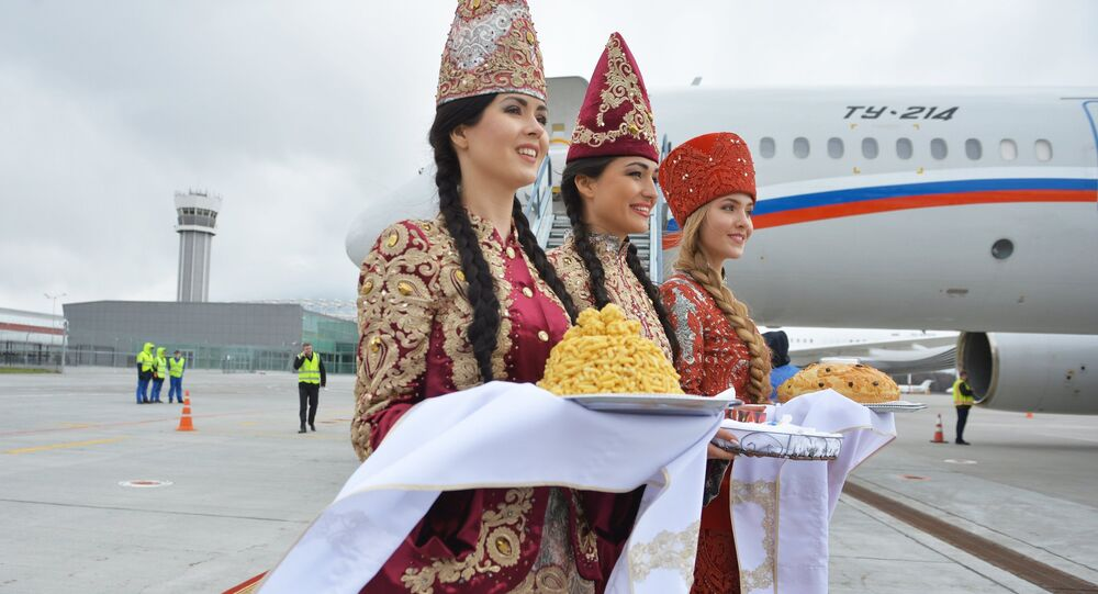 Girls in traditional costumes at Kazan airport