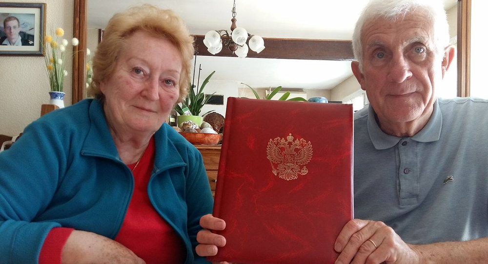 Jean Claude and Micheline Mague, with their official invitation from Vladimir Putin to visit Moscow on Victory Day.