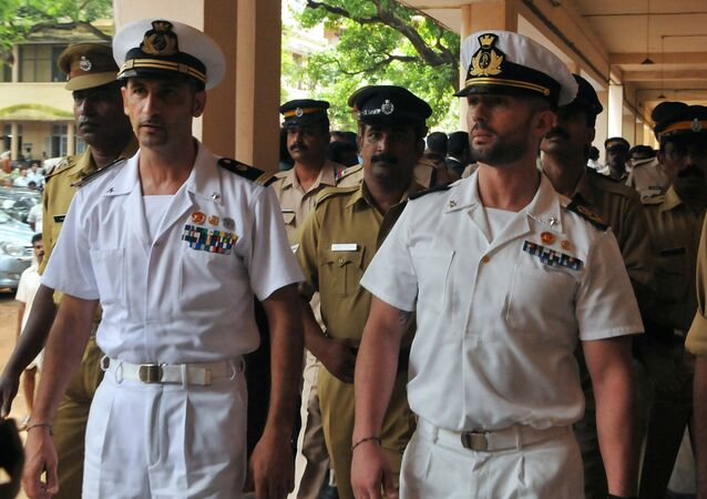 Italian marines Latore Massimiliano (2L) and Salvatore Girone (2R) are escorted by Indian police outside a court in Kollam on May 25, 2012
