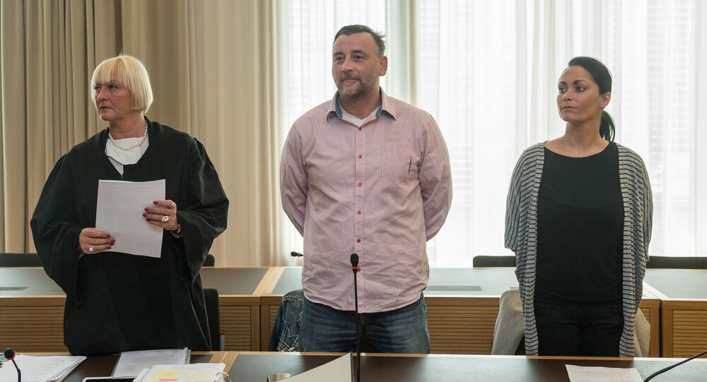 Lutz Bachmann (C), co-founder of Germany's xenophobic and anti-Islamic PEGIDA movement (Patriotic Europeans Against the Islamisation of the Occident), stands between his lawyer Katja Reichel (L) and his wife Vicky Bachmann (R) as he waits for the continuation of his trial on May 3, 2016 in Dresden, eastern Germany