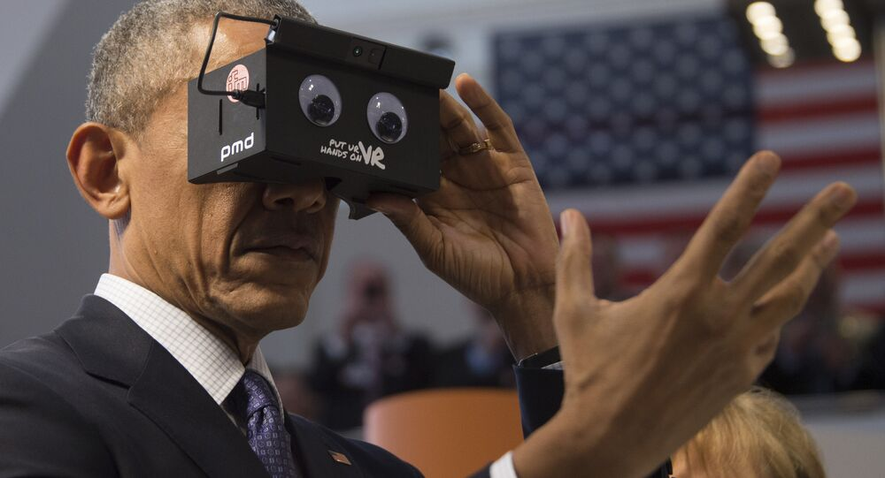 US President Barack Obama looks through a virtual reality device at the booth of German automation company ifm electronic as he tours with the German chancellor the Hanover industrial Fair in Hanover, central Germany, on April 25, 2016