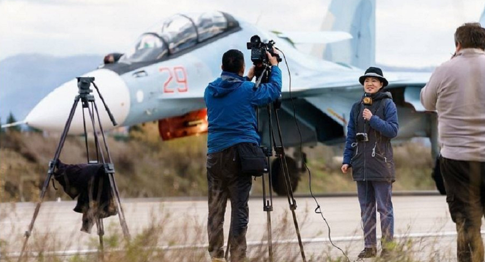 This file photo shows foreign journalists at the Hmeymim airbase in Syria