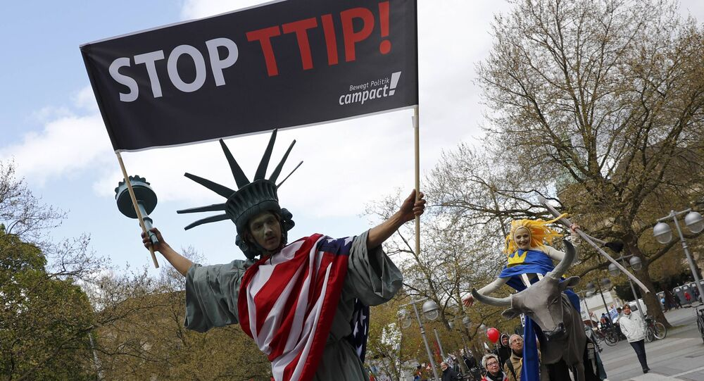 Protesters depicting Statue of Liberty (L) and Europa on the bull take part in a demonstration against Transatlantic Trade and Investment Partnership (TTIP) free trade agreement ahead of US President Barack Obama's visit in Hanover, Germany April 23, 2016.