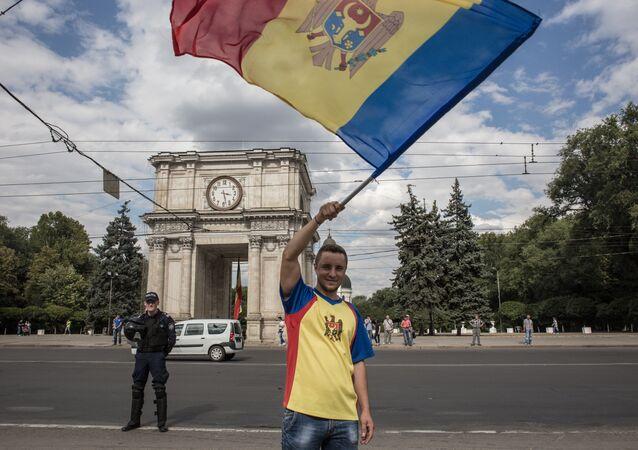 Man waves Moldovan flag in Chisinau