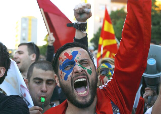 A demonstrator is seen with his face painted in support of a colorful revolution during a protest against the government, in front of the EU office in Skopje, Macedonia April 21, 2016.