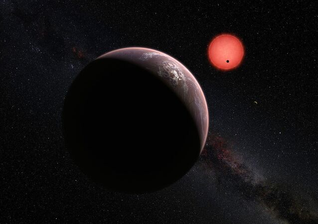 This artist's impression shows an imagined view of the three planets orbiting an ultracool dwarf star just 40 light-years from Earth that were discovered using the TRAPPIST telescope at ESO's La Silla Observatory.