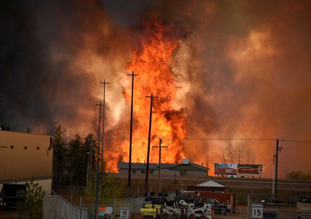 Flames rise in Industrial area south Fort McMurray, Alberta Canada May 3, 2016.