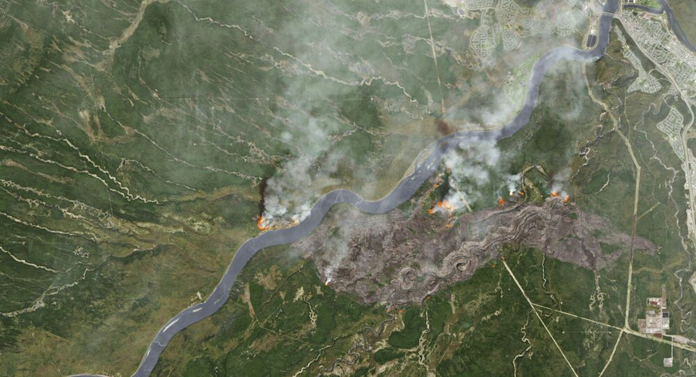 Smoke from wildfires near Fort McMurray, Alberta, Canada are shown in this satellite photo from NASA taken May 3, 2016.