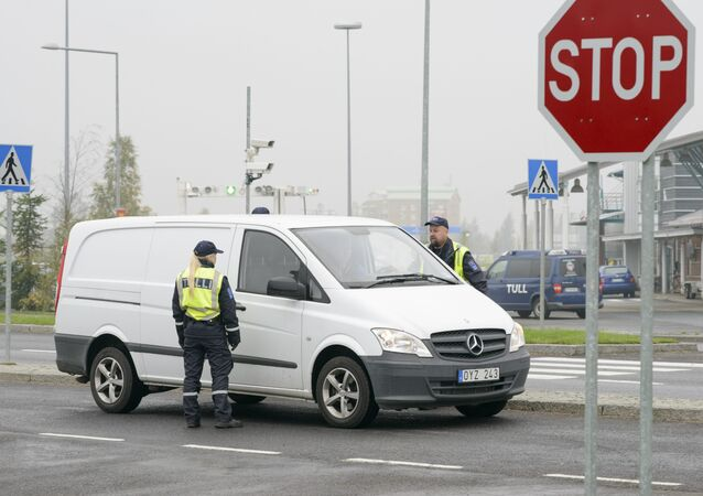 Finnish customs officers stop and inspect cars on Finland's northern border with Sweden to prevent illegal immigration and human trafficking.