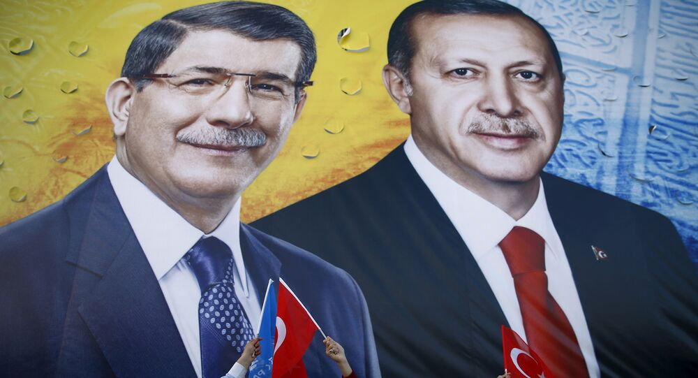 A banner showing Turkish President Tayyip Erdogan and Prime Minister Ahmet Davutoglu (L) together during an election rally in the central Anatolian city of Konya, Turkey, October 30, 2015.