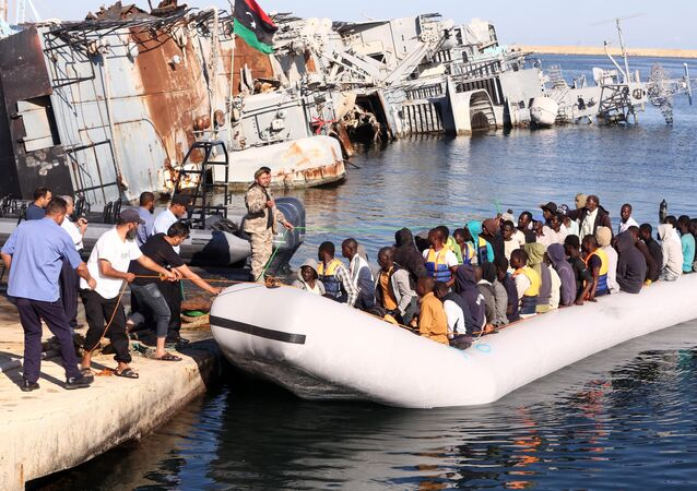 The Libyan coastguard pull a boat carrying illegal African migrants, intercepted as they were trying to reach Europe, at a naval base near the capital Tripoli on 29 September 2015.